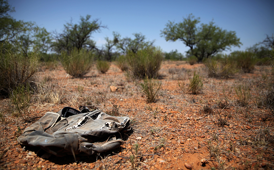 A migrant's torn backpack in the Sonoran desert between the US and Mexico